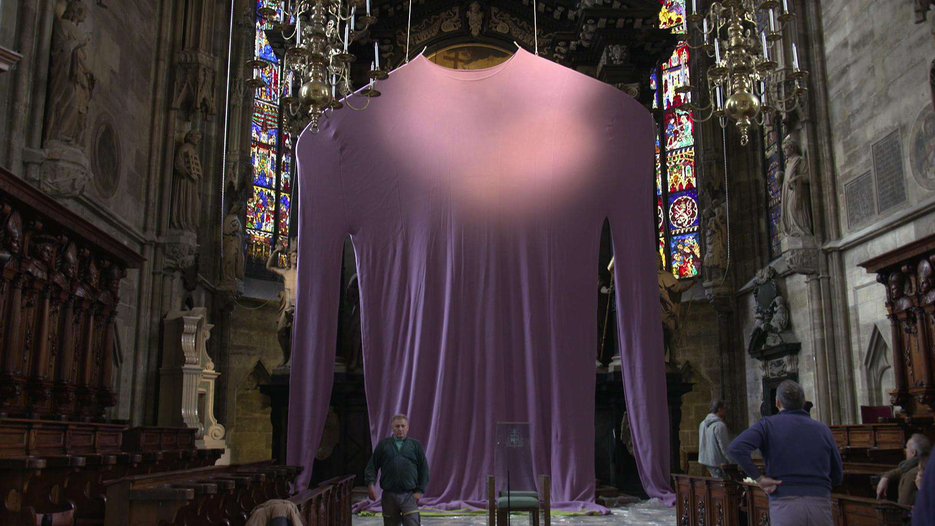 Vienna Cathedral Displays 'Porn' Artist's Giant Purple Sweater for Lent